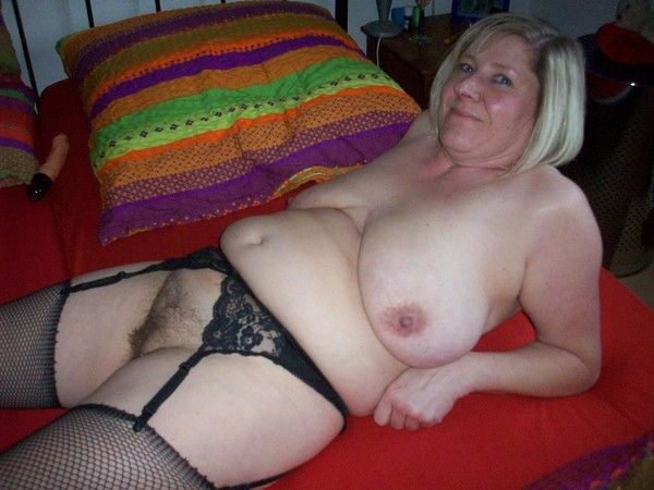 A plump middleaged woman with a wide ass and 2 guys 6
